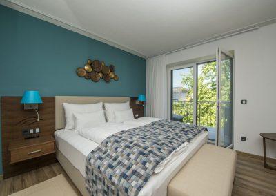 Doppelzimmer mit Balkon_seitlicher Seeblick_Boutiquehotel_Wörthersee